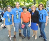 Photo_1-_Deloitte_volunteers_with_STAR_client_and_house_resident_John_Haney__center__and_STAR_Executive_Director_Katie_Banzhaf.jpg