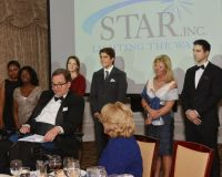 2-STAR_Gala_Speakers_Left_to_right_Speakers_Haly_Coleman__Sandy_Williams_Stacy_Tie__Lee_Gardella__Maggie_Marchesi__Patrick_Heavey._In_front__STAR_President_Obie_Harrington_Howes_and_Exec_Dir_Katie_Banzhaf._Mig.jpg